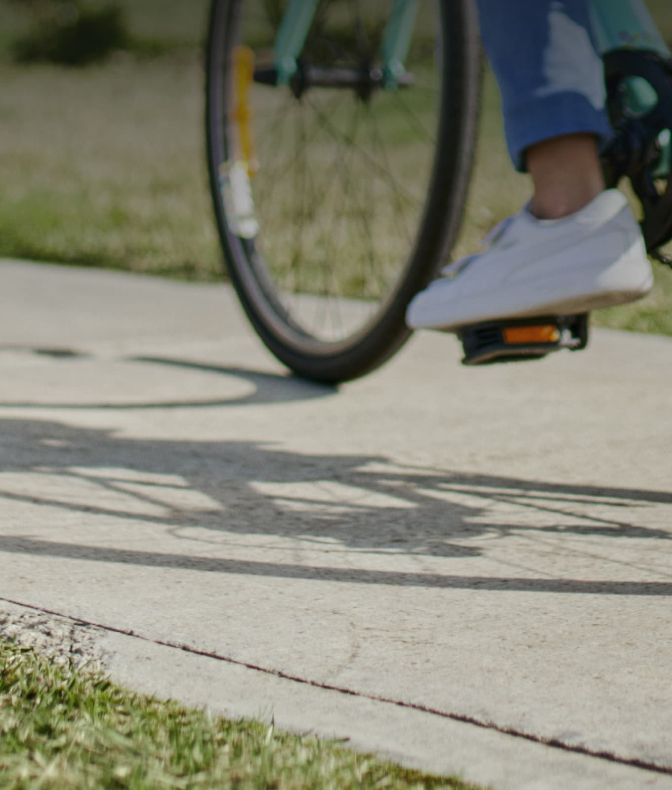 Cyclist riding on a bike path at Alira in soft focus